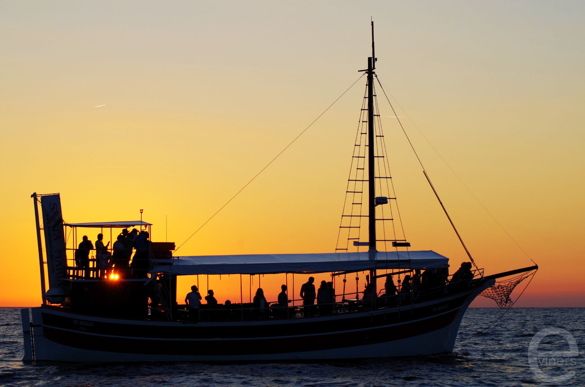 Boat in Front of the Setting Sun